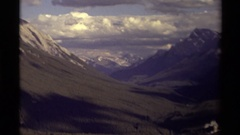 1979: a scenic view of white capped mountains and a valley CANADA Stock Footage