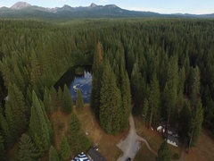 Aerial View of Rural Campground With Mountains in Background Stock Footage