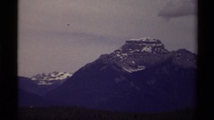 1979: snow sits in the cracks on the face of a tall mountain CANADA Stock Footage