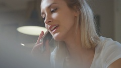Young pretty woman using phone at home. Arkistovideo