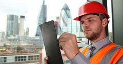 UK Engineer Man Taking Notes on Clipboard Examine Construction Development Area Stock Footage