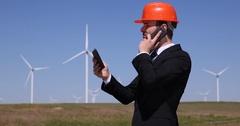 Businessman Inspect Talking Mobile Phone Using Digital Tablet Management Plans Stock Footage
