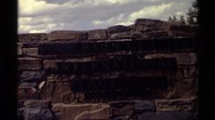 "1979: stone-wall sign shows ""waterton glacier international peace park""  Stock Footage"