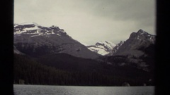 1979: a large area with lots of grass and a mountain around BRITISH COLUMBIA Stock Footage
