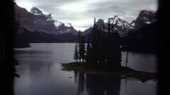1979: a small group of trees nestled on a small plot of land in maligne lake Stock Footage