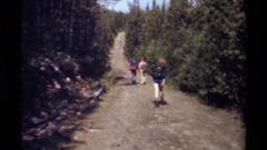 1979: kids walking down a road BRITISH COLUMBIA CANADA Stock Footage