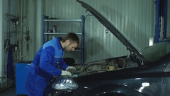 Portrait of a mechanic at work in his garage Stock Footage