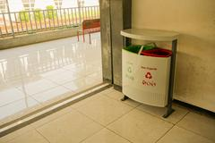 Trash can or box with organic and non- on pondok cina station in depok java Stock Photos