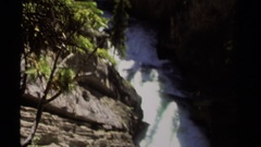 1979: water flows swiftly down the uneven riverbed in the wilderness Stock Footage