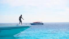 Sailor speedboat anchors Stock Footage