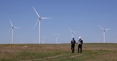 Business People Walking on Wind Turbines Field and Talking About Collaboration Stock Footage