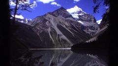1979: the perfect mirror image of a snow capped peak seen in the lake below Stock Footage