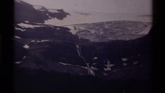 1979: pretty view of mountains in front of a lake CANADA Stock Footage