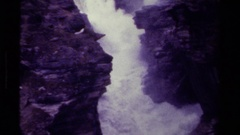 1979: a raging river flows swiftly down a narrow passageway CANADA Stock Footage