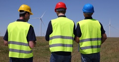 Engineer Men Walking Environmental Field Talking Alternative Energy Wind Turbine Stock Footage