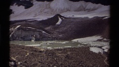 1979: a small, shallow puddle sits at the foot of a mountain CANADA Stock Footage