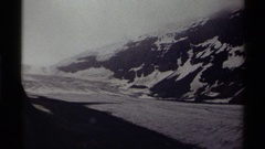 1979: grey day with ice fields and ice and snow on adjacent hill CANADA Stock Footage