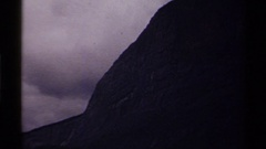 1979: rocky steep slope, saddle, alpine peak peeking over the ridge  Stock Footage