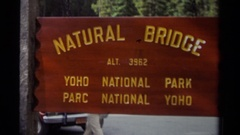 1979: there is a big board of natural bridge which is in red colour CANADA Stock Footage