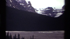 1979: lake with rugged mountains in the background and exposed rock  Stock Footage