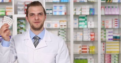 Happy Pharmacist Man Talk Tablets Description Show Pills Pharmacy Store Concept Stock Footage