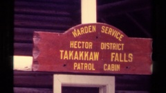 1979: sign: warden service hector district takakkaw falls patrol cabin; cabin Stock Footage