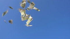 One hundred euro bills falling against blue sky Stock Footage