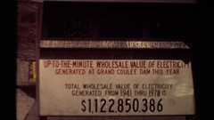 1979: a sign indicates the value of electricity created by a dam  Stock Footage