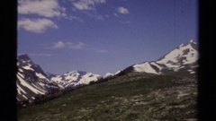 1979: panning view of mountainous slopes and grassy sloping hills.  Stock Footage