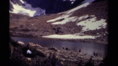 1979: people camping near river and sitting on river bank BRITISH COLUMBIA Stock Footage