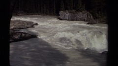 1979: river dropping in gradient to form some small whitewater rapids CANADA Stock Footage