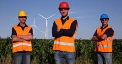 Happy Wind Turbine Worker Men Team Posing Smiling and Looking Camera  Farm Field Stock Footage