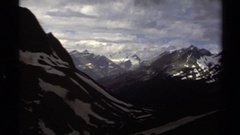 1979: focusing deep into the snowy mountains and shadows of the clouds BRITISH Stock Footage