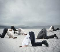 Fear of crisis with businesspeople like an ostrich Stock Photos