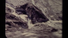 1979: a river flows through rough terrain. BRITISH COLUMBIA CANADA Stock Footage