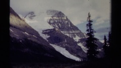 1979: snow covering huge mountains with trees BRITISH COLUMBIA CANADA Stock Footage