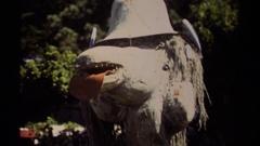 1980: statue like animal between garden MENDOCINO CALIFORNIA Stock Footage