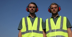 Airport Logistics Men Employee Look Camera Posing Thumb Up Sign in Airport Area Stock Footage