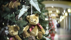 Plush bear balls and fir cone. New Year's and abstract blurred shopping mall Stock Footage