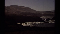 1980: pan view showing the landscape in daylight around a water body  Stock Footage