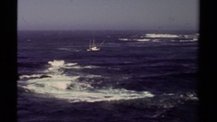 1980: ship sailing into the sea, away from the viewer, with large waves around Stock Footage