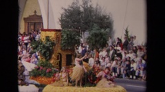 1967: float in a parade with hula dancers LOS ANGELES CALIFORNIA Stock Footage