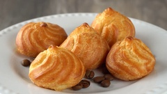 Delicious homemade pastry with coffee beans on a white plate. Seamless loopable Stock Footage