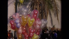 1967: a large amount of balloons outside LOS ANGELES CALIFORNIA Stock Footage
