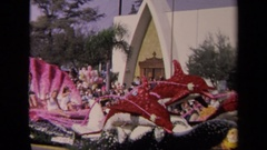 1967: a machine goes past lots of people at a parade LOS ANGELES CALIFORNIA Stock Footage