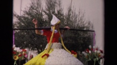 1967: a girl in red dress waving to large crowd who gathered to watch Stock Footage