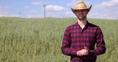 Agriculturist Smiling at Camera and Showing Thumb Up Sign in Unripen Oat Field Stock Footage