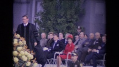 1967: ronald reagan inauguration a reverend in robes walks in front  Stock Footage
