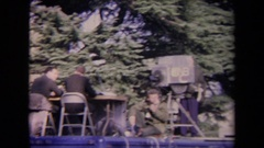 1967: ronald reagan inauguration people walk down the street at an event filmed Stock Footage