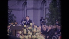 1967: ronald reagan inauguration group of people outside listening to a man  Stock Footage